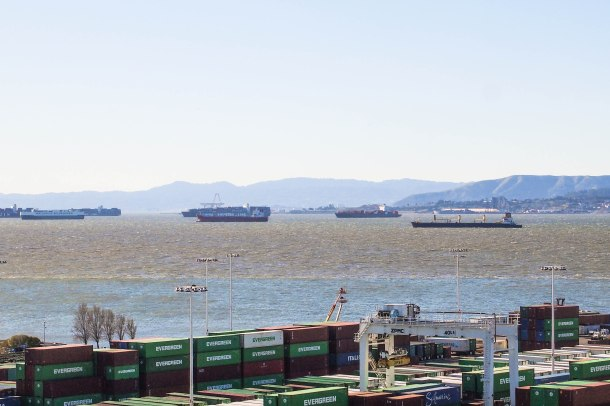Scores of ships wait in an anchorage off the coast because the port of Oakland is at full capacity.
