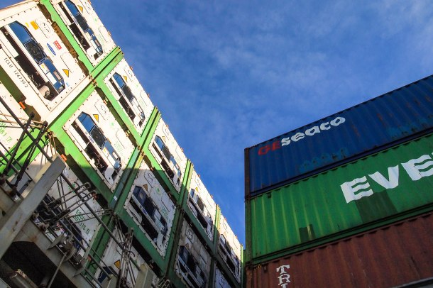 On the left, reefer (refrigerated) containers rise into the air and below deck, carrying fresh and frozen goods to China.