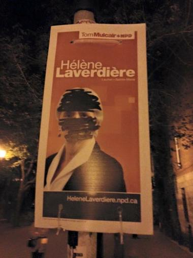 A campaign sign for NDP candidate Hélène Laverdière in Montreal, showing anti-niqab graffiti as the NDP fell in the polls.